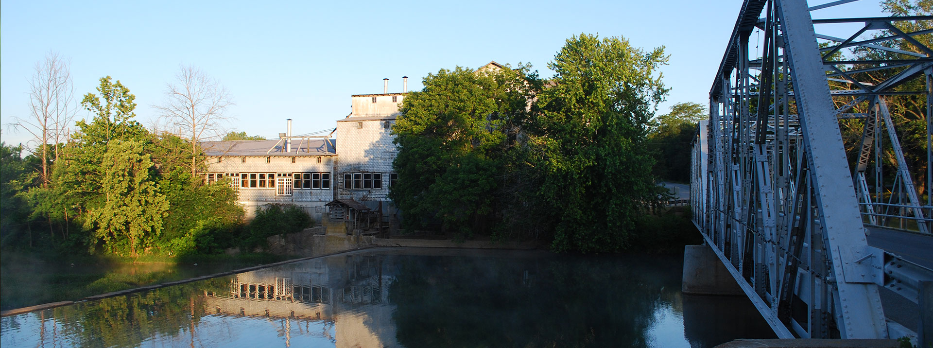 Ozark Mill with bridge and soft river.